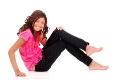 Happy young girl sitting Royalty Free Stock Images