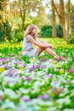 Happy young girl sitting on the grass Royalty Free Stock Photography