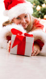 Happy young girl smiling with gift box Stock Photos