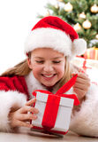 Happy young girl smiling with gift box Stock Photo