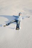Happy young girl in snow. Happy young girl lying in snow Stock Photo