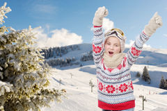 Happy young girl snowboarding, skiing in background Stock Images