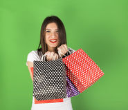 Happy young girl  with spotty bags Stock Photography