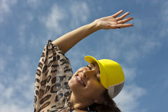 Happy young girl on the street. hands up royalty free stock photography