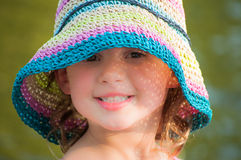 Happy young girl with sun hat Royalty Free Stock Image