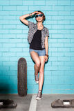 Happy young girl in sunglasses with skateboard having fun in fro Royalty Free Stock Images