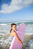 Happy young girl with surfboard Stock Photos