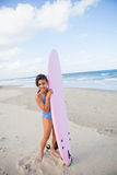 Happy young girl with surfboard Stock Photo
