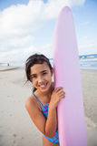 Happy young girl with surfboard Stock Photography