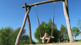 Girl on a swing. Happy young girl on a swing stock footage