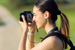Happy Young girl taking photos in the field Stock Images