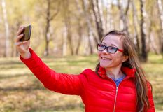 Happy young girl taking selfie. Photo of happy young girl taking selfie Royalty Free Stock Images