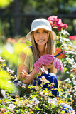 Happy young girl  in uniform at yard gardening Royalty Free Stock Images