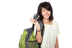 Happy young girl with vintage camera going on vacation Stock Photo