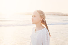 Happy Young Girl Walking at the Beach Stock Photos