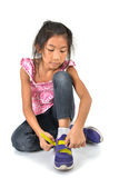 Happy Young girl wearing sport shoes on white Stock Images