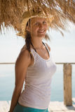 Happy young girl in white tank top stock images