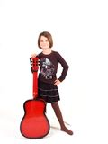 Happy Young Girl With Her Red Guitar Royalty Free Stock Photos