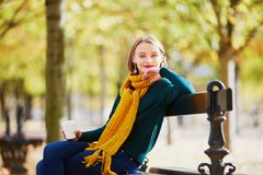 Happy young girl in yellow scarf walking in autumn park Stock Photography