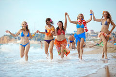 Happy young girls. Group of young beautiful girls having fun at beach Royalty Free Stock Photography