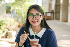 Happy young girls with Chocolate Drink Stock Photos