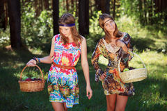 Happy young fashion girls walking in a forest royalty free stock photo