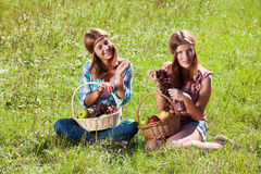 Happy young girls with a fruit basket Stock Photo