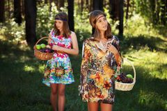 Happy young girls with a fruit basket on nature Royalty Free Stock Photo