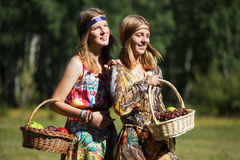 Happy young girls with a fruit basket on nature Royalty Free Stock Photos