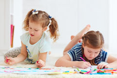 Happy young girls, kids painting with felt pen together Stock Photography