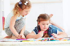 Happy young girls, kids painting with felt pen together Stock Image