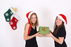 Happy young girls with present Stock Photo