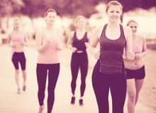 Happy young girls during racewalking training royalty free stock photography