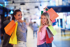 Happy young girls in  shopping mall. Friends having fun together Royalty Free Stock Images