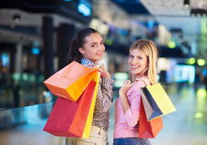 Happy young girls in  shopping mall. Friends having fun together Royalty Free Stock Photos