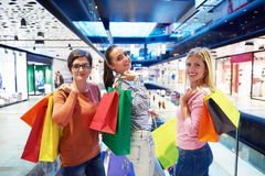 Happy young girls in  shopping mall. Friends having fun together Stock Image