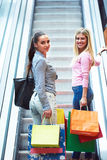 Happy young girls in  shopping mall. Friends having fun together Royalty Free Stock Photography
