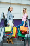 Happy young girls in  shopping mall. Friends having fun together Royalty Free Stock Photo