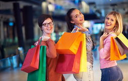 Happy young girls in  shopping mall Royalty Free Stock Photo