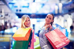 Happy young girls in  shopping mall. Friends having fun together Stock Images