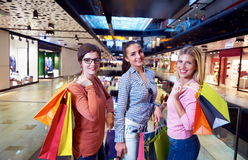 Happy young girls in  shopping mall. Friends having fun together Stock Photography