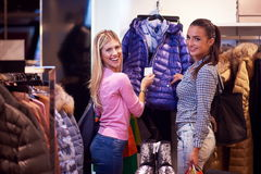 Happy young girls in  shopping mall. Friends having fun together Stock Photo