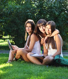 Happy young girls study in a park Stock Image