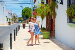 Happy young girls, tourists walking on streets in city tour, Santo Domingo Royalty Free Stock Images
