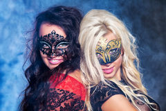 Happy Young Girls Under Masks On The Party Royalty Free Stock Images