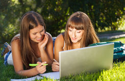 Happy young girls using a computer Royalty Free Stock Photo
