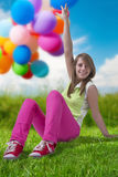 Happy teenage girl with balloons Stock Image