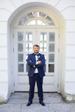 Happy young groom with a beard on their wedding day. Bearded man in a stylish suit groom Stock Photos