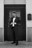 Happy young groom with a beard on their wedding day. Bearded man in a stylish suit groom Stock Photography