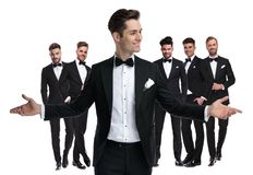 Happy young groom welcomes you to be his best man stock image